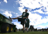 Colorado State sophomore punter, Jimmie Kaylor (cq), from Northglenn, Colo., stretches before...