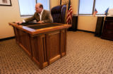 (DENVER, Colo., Aug 31, 2005) Weekend wood worker and mayor of Aurora Ed Tauer sits behind his...