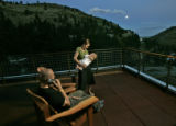 HGTV Dream House.  Tina Galgon-Herr feeds her daughter Talia on the deck of their new house, while...
