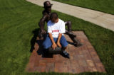 (Loveland, Colo., July 25, 2004) Jeremy Jordan, 13, of Loveland, rests after rollerblading next to...
