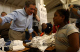 Colorado Governer, Bill Owens, left, speaks with  Kayla Aguillard (cq),7, right of New Orleans,...