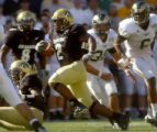 Second year tail back for the University of Colorado, Hugh Charles (cq), #2, makes a touch down...