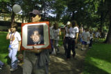 Deborah Mendez-Wilson (cq) carries a sign of her late brother Jay Quintana (cq), during 18th...
