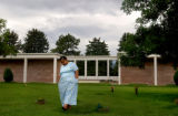 Helen Childes walks away from the grave side of her son  Pauls Childs after placing a vase of...