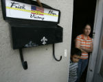 Azucena Hurtado (cq) stands in her doorway with her 5 year old son Geraldo, Monday August 22,...
