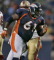 Denver Broncos Gerrard Warren, #61, who is listed at 325-lbs. on the team roster, rolls down the...