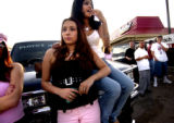 Denver, Colo., May 2, 2004- Monique Trujillo (LEFT) and Leslie Linares (right) rest on the hood of...