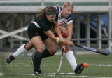 Kent Denver Sun Devils' #21, Kelly Hopley, right, defends against Colorado Academy Mustang's #4,...