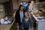 Maggie Engelsma (cq) gives her son Bryan Espinoza (cq), 8, a hug in their kitchen after dinner...