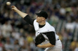 Aaron Cook pitches in the third inning against the Pittsburgh Pirates at Coors Field in Denver,...