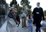 (left to right) Kareem Abdelqader,11, left, walks out of Ponderosa Elementary School, located at...