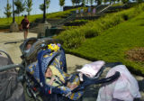 Baby Erin Barclay waits in his stroller outside Westminster City Park Fitness Center August 24,...