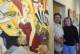 (Lt. to Rt.) Louis Recchia and wife Zoa Ace (CQ), both Artists pose next to some of Ace's work at...