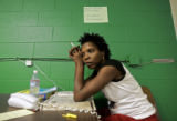 Hurricane Katrina evacuee Troylynn Smith (cq), 42, of New Orleans pauses in exhaustion while...