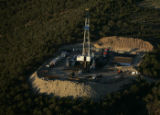 A natural gas drilling rig sits atop the Grass Mesa above Rife, Colo,  as a boom continues to...