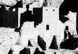 Shadows of two visitors to Mesa Verde's largest Anasazi ruin, Cliff Palace, are seen in this March...