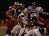 Pomona's Kyle Mericle breaks loose from Heritage's Joe Moore (4) for a long TD run for Pomona's...