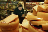 Denver, CO Sept. 12, 2005 Cheryl Franklin prices cheese in preparation for the grand opening of...