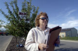 Sherry Caloia (cq) waits to gather signatures on Saturday August 27,2005  in an effort to recall...