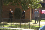 Denver police walk through a housing complex at 11th Ave. and Navajo on Monday August 29,2005....