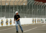Driver Leighton Reese (cq), with Banner Racing, roller-blades on the course to check out the track...