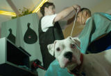 Rubi Esmeralda Hernandez(cq), left, cuts the hair of Hermi Tlaxcalteco(cq), right, while his dog...