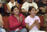 Shivali Bidaiah, 17,  and her sister Sonali Bidaiah, 19, , applaud as they watch a NASA feed at...