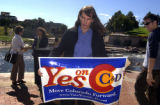 Elise Jones (cq) Executive Director of the Colorado Environmental Coalition holds  a Yes on...