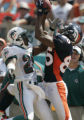JPM461 Denver Broncos Ashley Lelie, right, pulls in a pass against Miami Dolphins Sam Madison in...