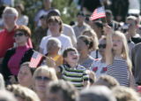 Henry Grant (cq), 3, left, and Sofia Grant, 6, right, (brother and sister), wave flags at a...