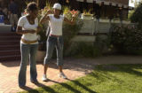 LeLanna Simmons, (cq)senior, left of frame, works on a dance move with her friend Brittany...
