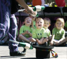 Denver, CO Aug. 30, 2005  Aidan Olsen (front, center), 4, and Ryley Darnell, 3, along with other...