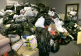 Waldron Reweti (cq),43, of Denver, Colo., carries bags of donated clothing from out of Hanger No....