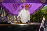 Executive Chef of Trinchero Family Estates, Jeffrey Starr, cooks some chicken on a grill August...
