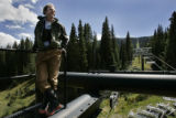 Davey Pitcher stands on top of the lift tower at the base of the Alberta lift at Wolf Creek Ski...