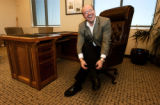 (DENVER, Colo., Aug 31, 2005) Weekend wood worker and mayor of Aurora Ed Tauer fixes his pant leg...