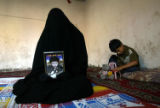 NYT94 - (NYT94) BAGHDAD, Iraq -- Aug. 13, 2004 -- IRAQ-MILITIA-FAMILY-2 -- Ayam Mohamed, 19, a...