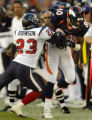 (Denver, Colo., November 7, 2004) Rod Smith is pushed out of bounds by Dunta Robinson after...