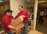 (Highlands Ranch, Colo., October 28, 2004) Mark Bliton, right, stacks boxes of Bush placards in...