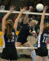 (DENVER, CO., NOVEMBER 12, 2004)  CS Christian's #14, Holly Whitlow, center, splits the defense of...