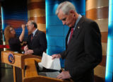 (DENVER, CO., OCTOBER 29, 2004)  Republican Senate Candidate, Pete Coors, right, checks his notes...
