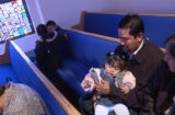 (Denver, Colo., October 31, 2004) Jose Barr—n holds his daughter Eunice Barr—n, 1 year, while...