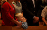 (FOXFIELD, Colo., Oct.  31, 2004) Our Lady of Loreto Church. Carek Chamberlain attends the 7 a.m....