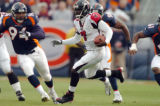 (DENVER, CO., OCTOBER 31, 2004) Denver Broncos' defenders, #94, Luther Eliss, #98, Reggie Hayward,...