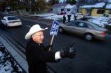 [Denver, CO - Shot on: 11/1/2004] Senate candidate Ken Salazar waves at motorists along with...