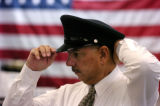 (LONE TREE Colo., November 16, 2004)  Richard Sanchez tries on a hat at Neve's Uniforms &...