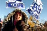 (DENVER, Colo., Nov. 2, 2004) Fofi Mendez of Denver supporter for SCFD 4B hold signs at the corner...