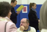 (CENTENNIAL, Colo., Nov. 2, 2004) Ron Bella, Polling Place observer, watches the progress of...