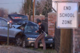 [(Littleton, CO, Shot on: 11/16/04)] State Patrol trooper Shannon Jones investigates a side impact...