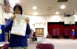 (AURORA , CO., NOVEMBER 2, 2004)   Zahra Khazi, of Aurora, seals her provisional ballot she casted...
